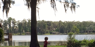 Child running through park